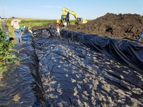 Plastic is lined along the bottom of the bioreactor keeping water from seeping through surrounding soil