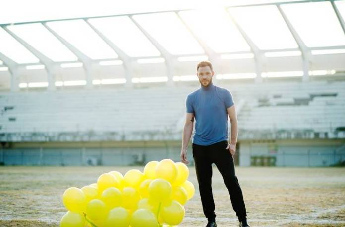 Will Young with some yellow balloons