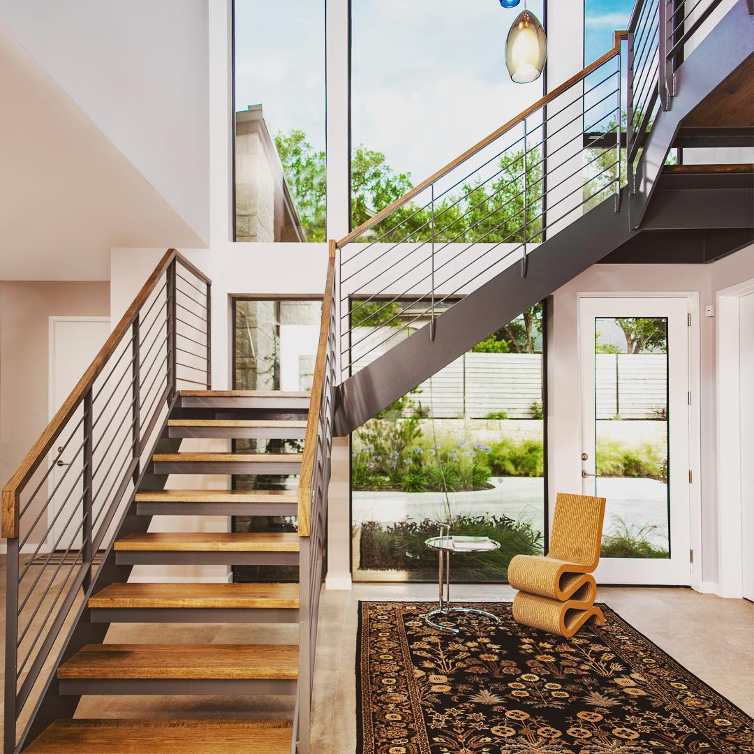 Steel and Hickory wood stairs highlight this two story entry. Built by @foursquarebuilders Designed by photo by @redpantsstudio
