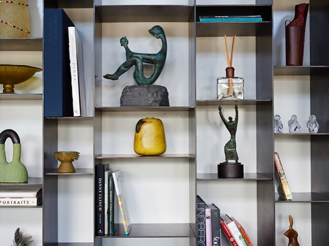 Blackened Steel shelving make for a great twist for curios. Built by @foursquarebuilders