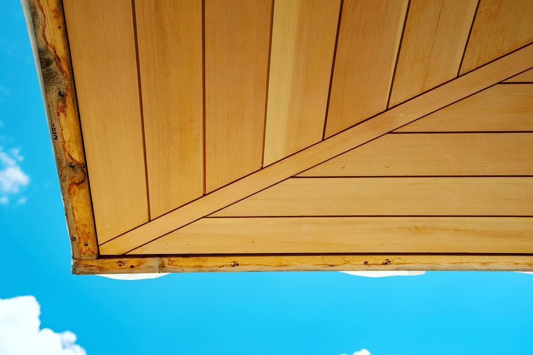 Vertical grain Douglas Fir Soffit complement blue skies. Built by @foursquarebuilders Photo by @redpantsstudio