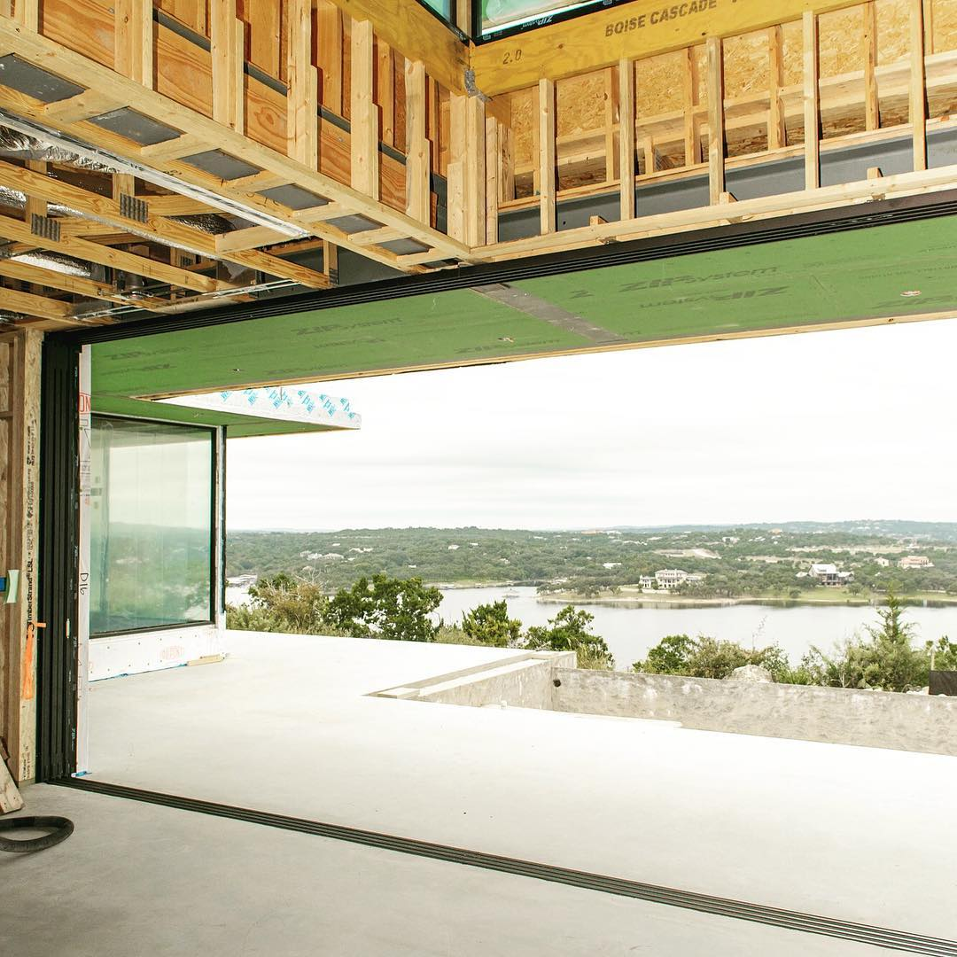 28' of Fleetwood sliding glass doors frame our clients view of Lake Travis. Built by @foursquarebuilders Designed by @dc_architecture Photo by @redpantsstudio @fleetwood_windows_doors