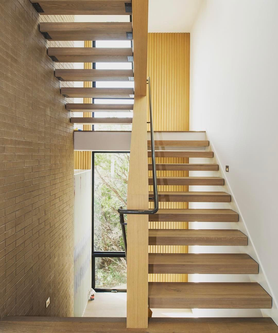 Floating white oak stair treads allow light to flow through this @foursquarebuilders home.