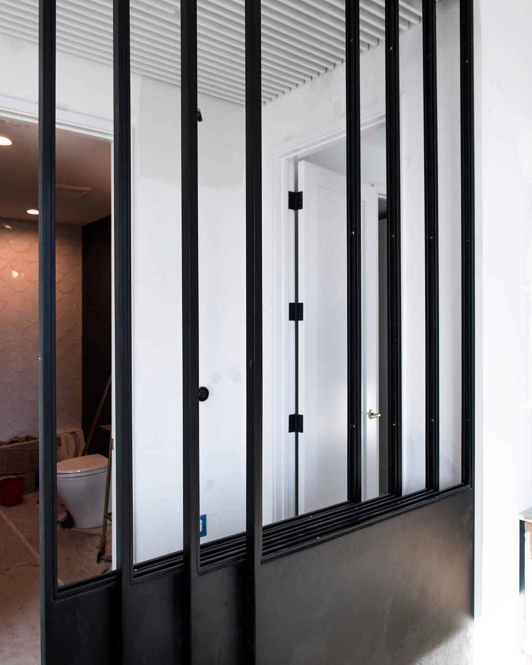 Steel & Glass retractable wall panels make this condo finish out!! Designed by @slicdesign built by @foursquarebuilders