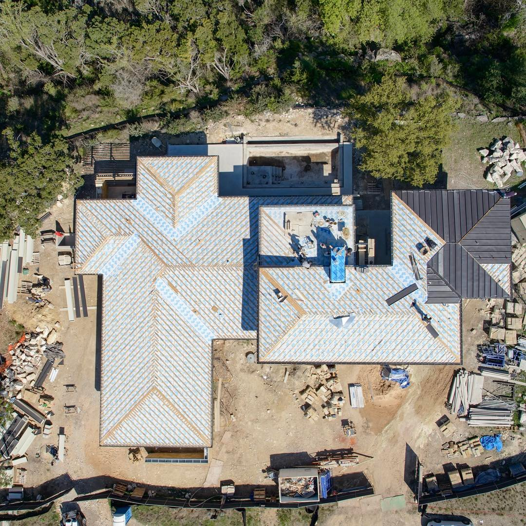 Ventilated roof structure provides for an energy efficient home. Built by @foursquarebuilders Designed by @dc_architecture Drone Photo by @redpantsstudio