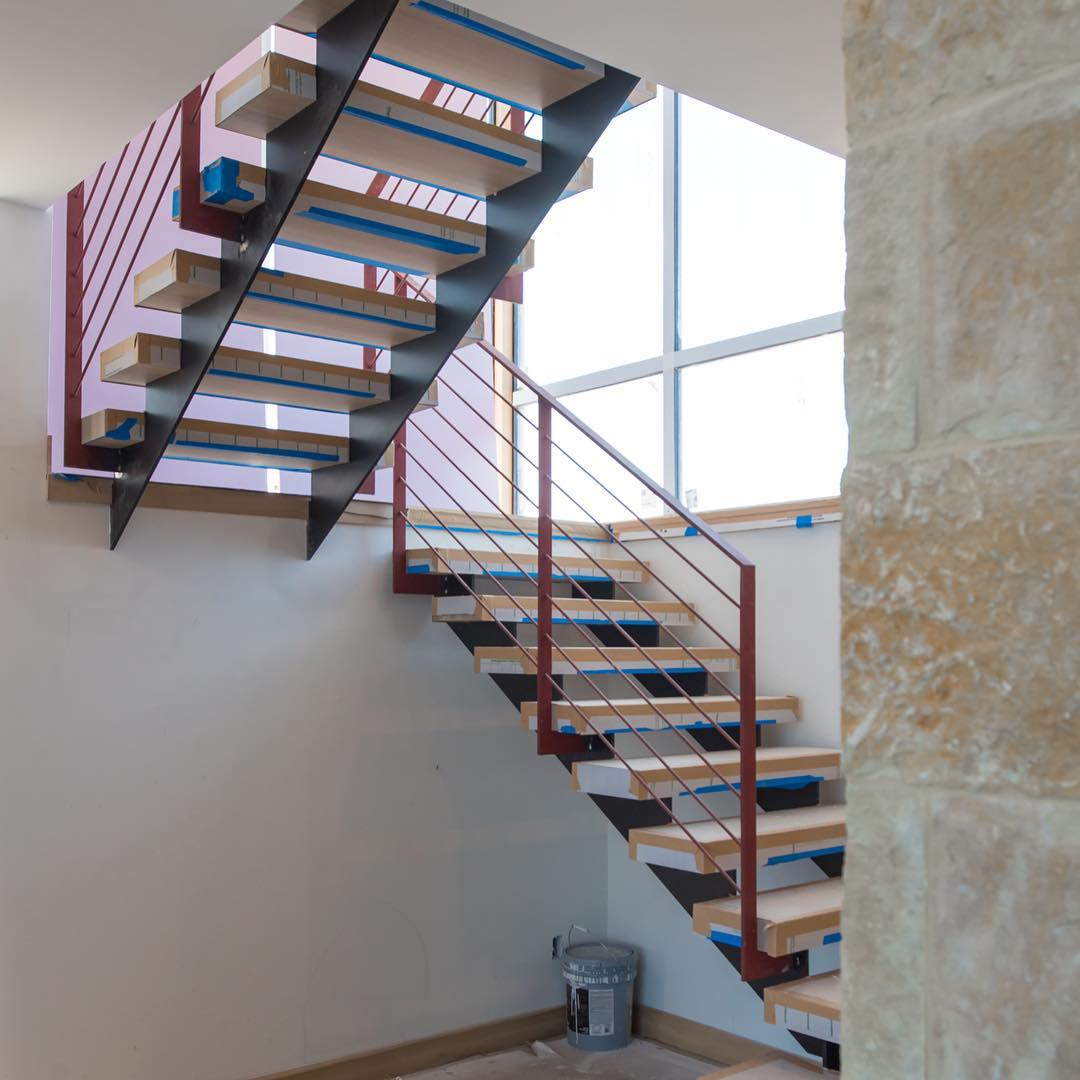 Plate steel stringers with solid oak treads make up this entry stair system designed by @dc_architecture Built by @austin_iron and @foursquarebuilders Treads by @ingrainedbynature Photo by @redpantsstudio