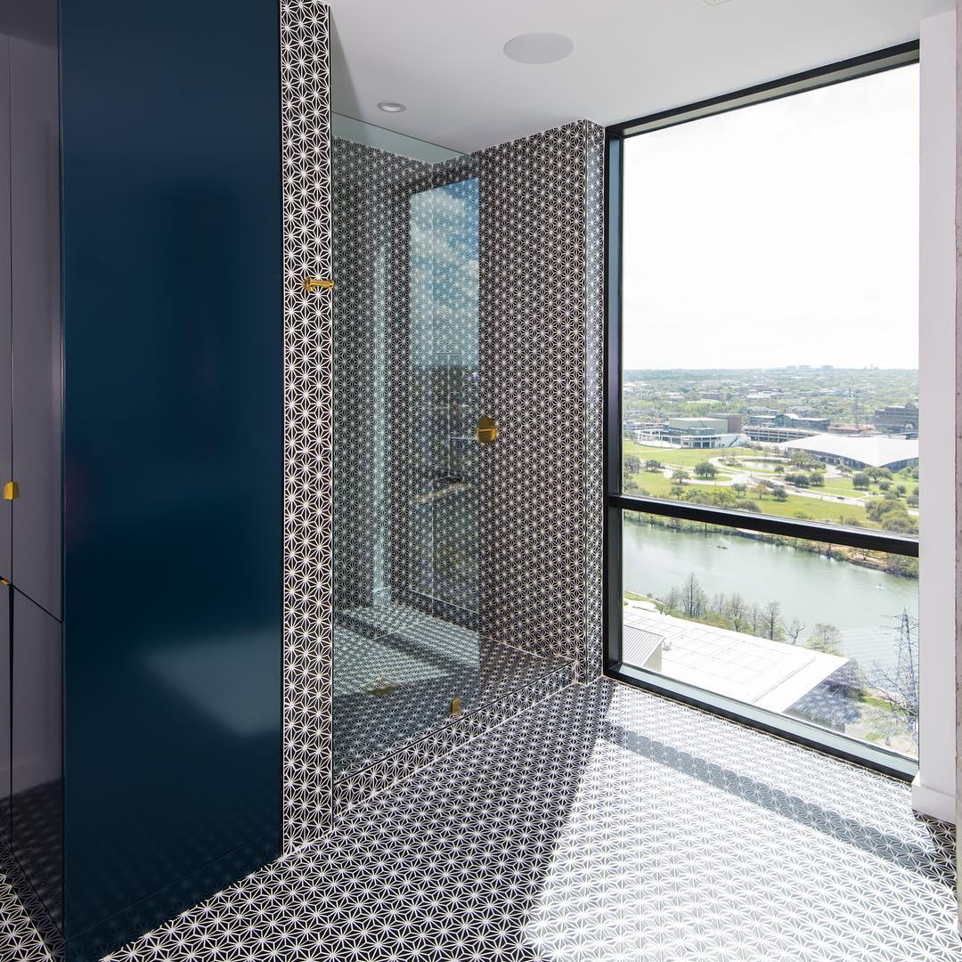 Recently completed Seaholm Condo finish-out.  Bathroom overlooking Lady Bird Lake. Built by @foursquarebuilders Design by @slicdesign Photo by @redpantsstudio