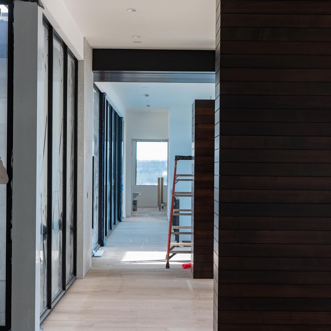 Proper hallways should simply allow us to transition between spaces without the confines of walls.