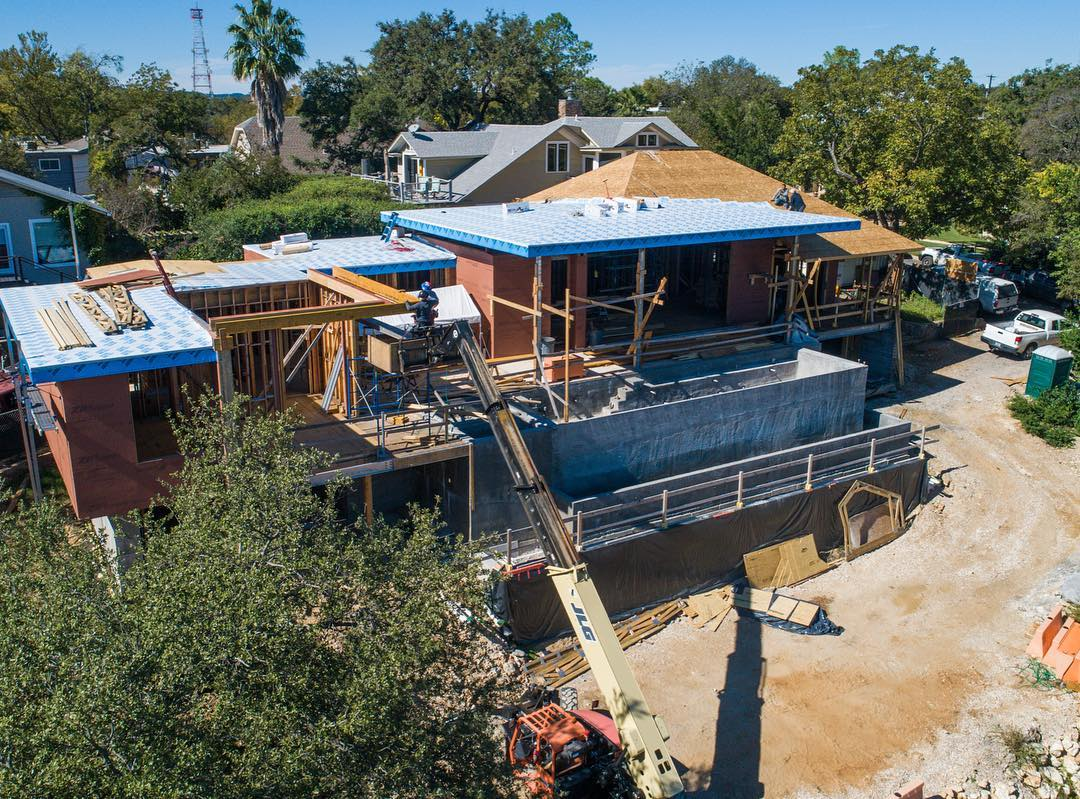 Great view of our West Austin home! Drone by @redpantsstudio Architecture by @laruearchitects Interior Design by @lovecounty