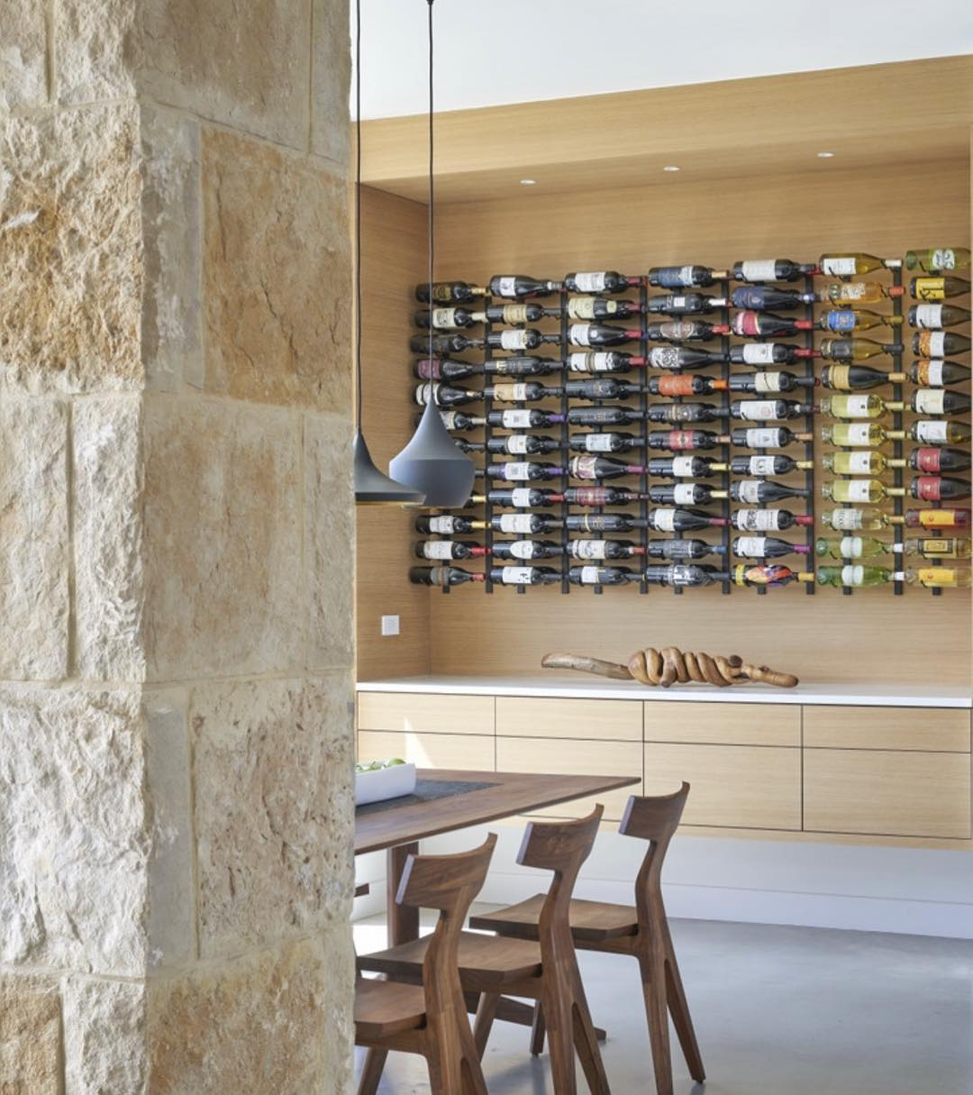 Fun wine rack solution for our Lake Travis clients. Designed by @dc_architecture Photo by @drorbaldingerphotographer