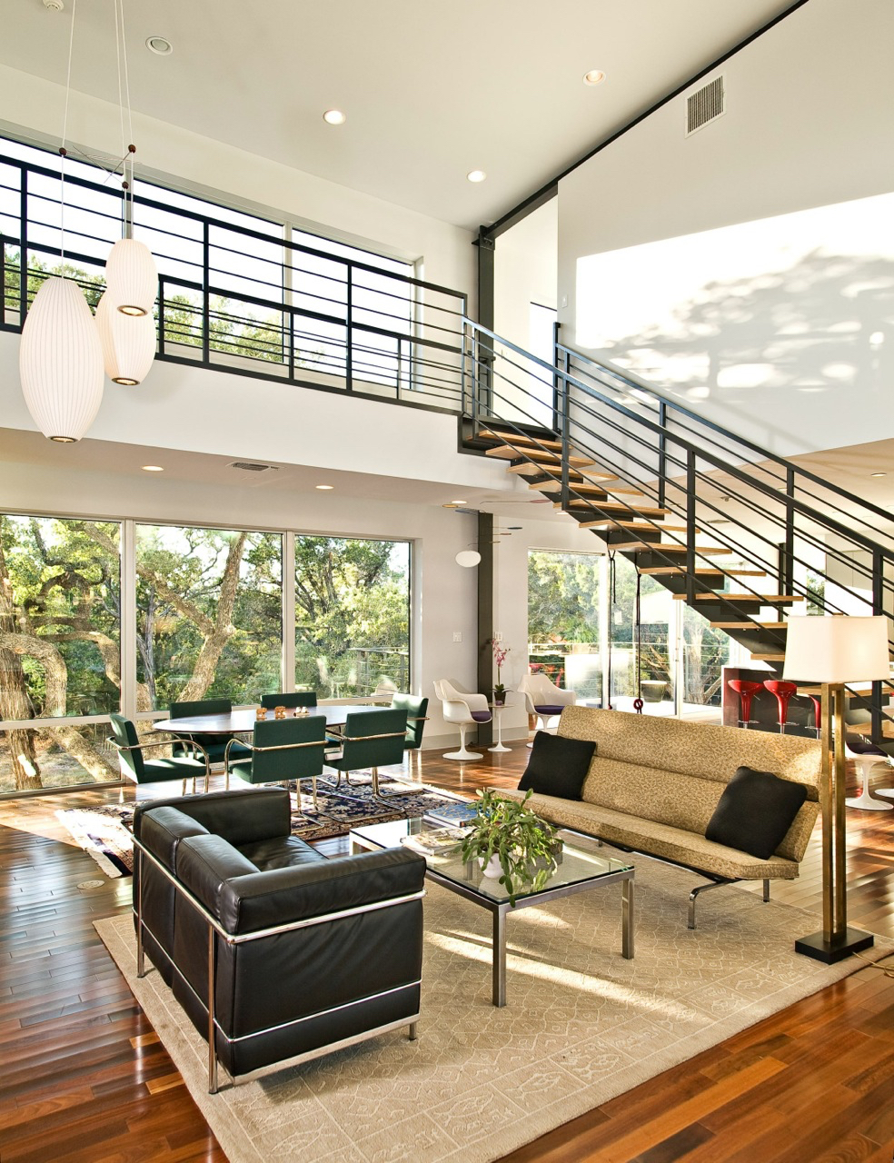 Hill country natural landscape creates wall art thanks to floor to ceiling windows.