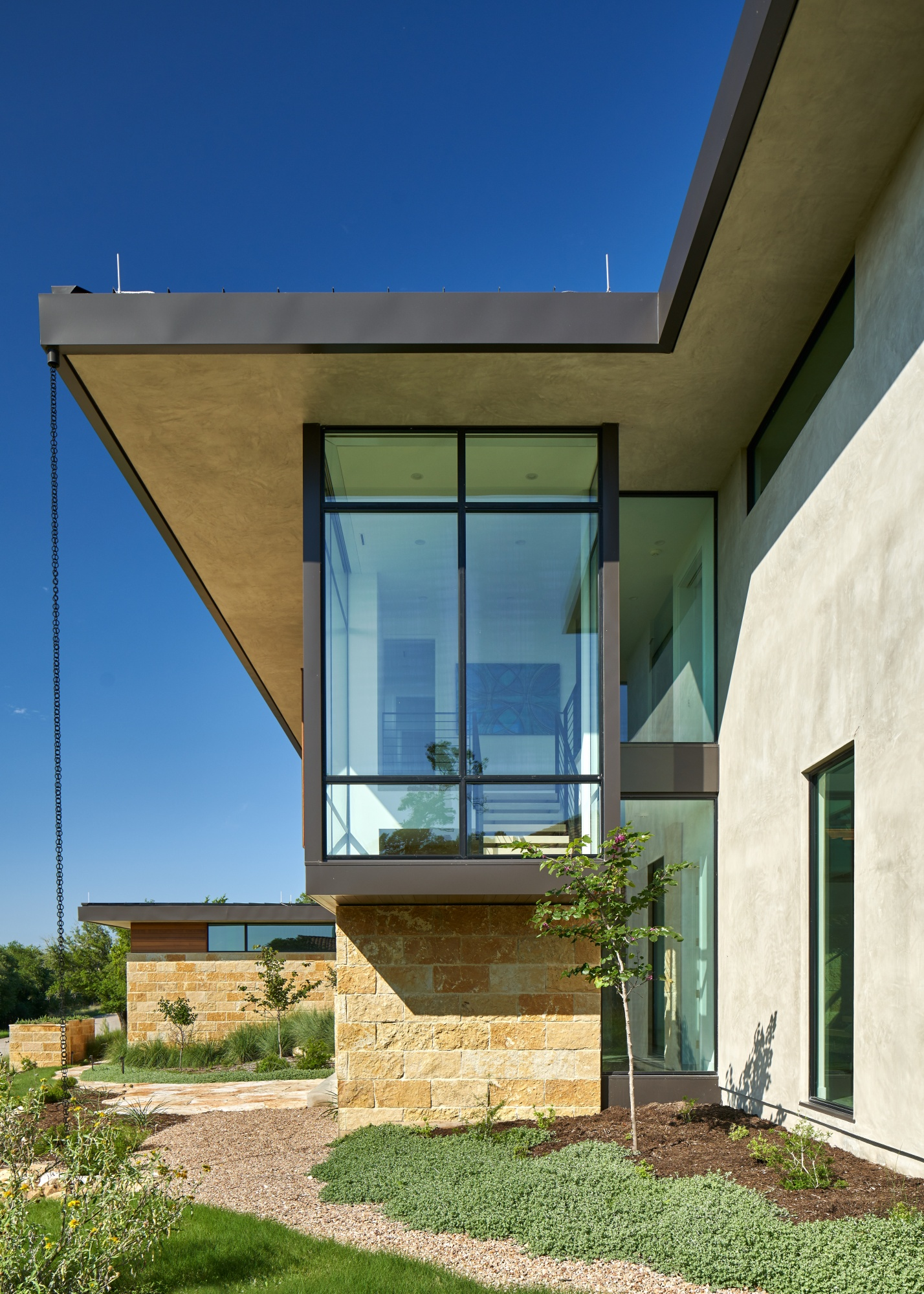 Deep roof overhangs provide shading and protection.