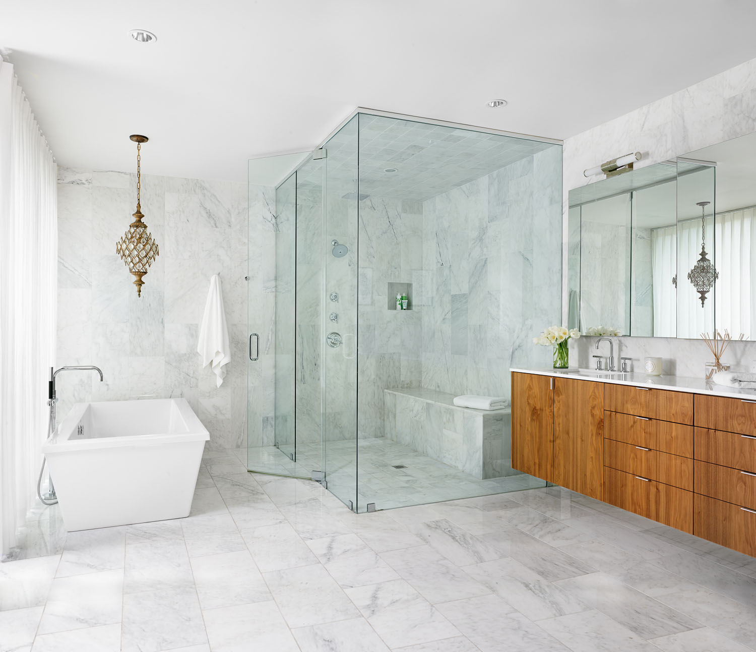 Marble floors and walls provide a spa liking feeling within the master bath.