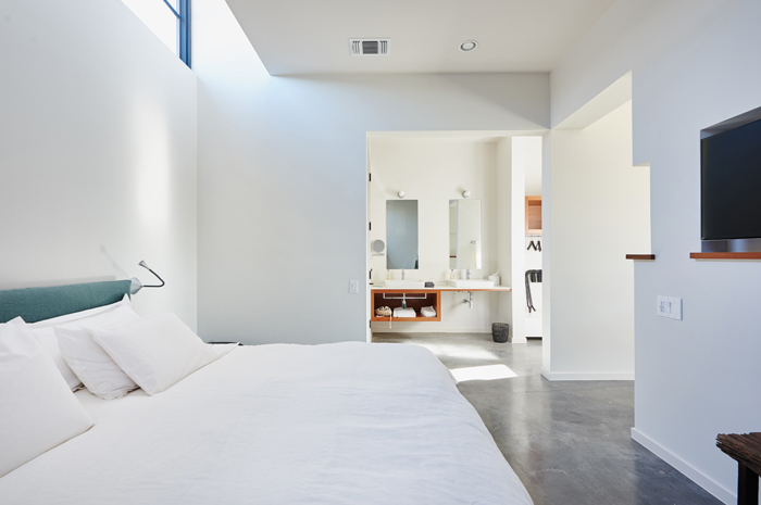 High windows provide natural light within this private guest room.