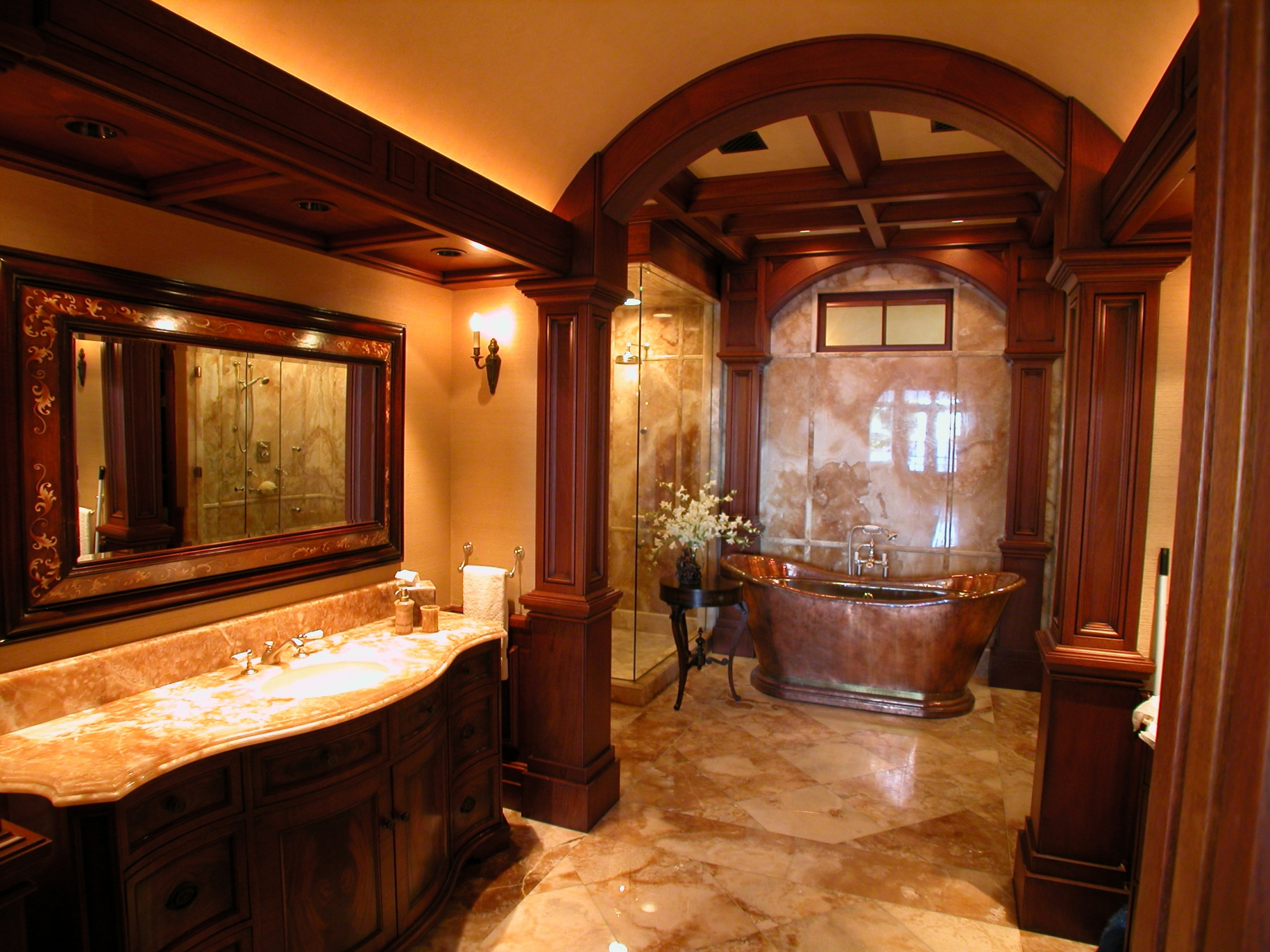 Custom built vanities with onyx tops in the master bathroom.