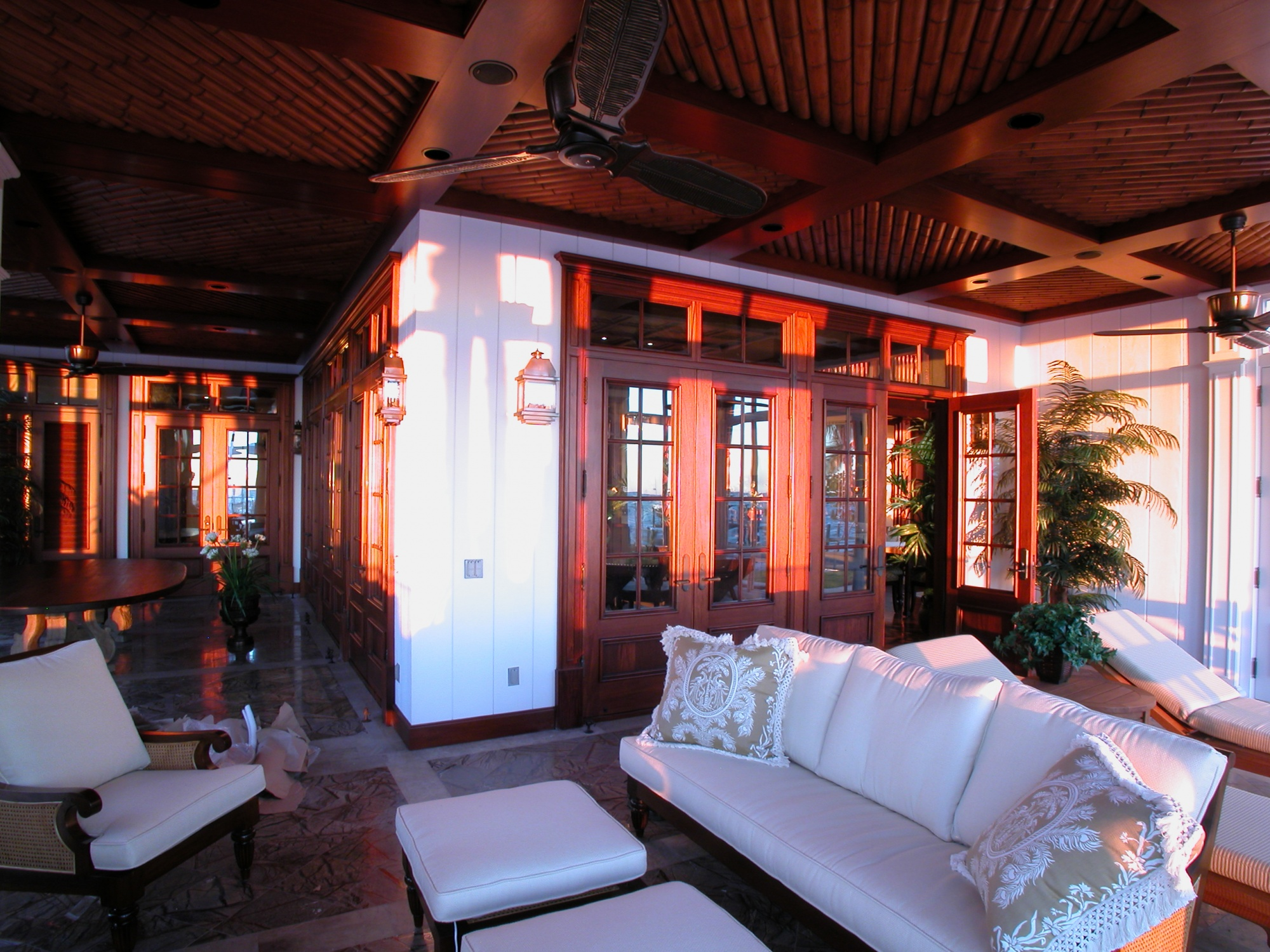 Bamboo ceilings are featured within the ocean side screen porch.