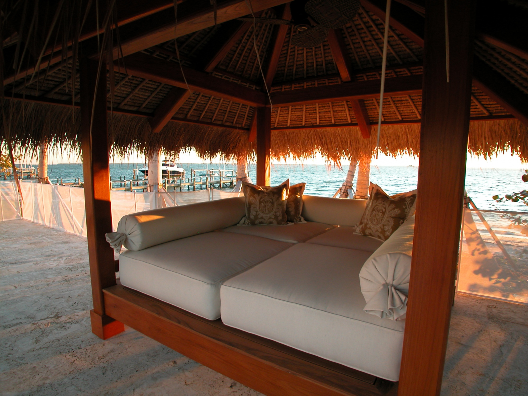 Authentic thatched roof with bamboo and mahogany rafters provide shelter on this oceanside day bed.
