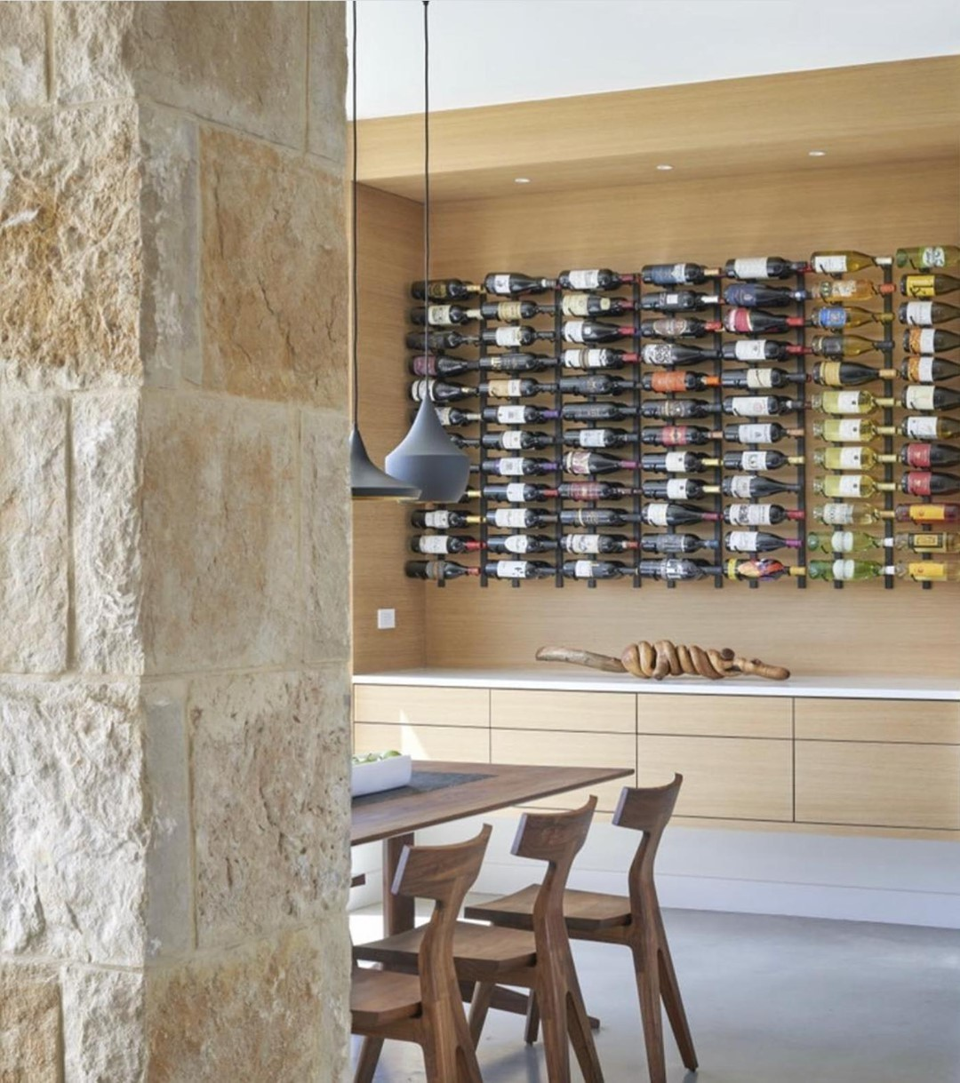 Now that's a wine rack! ⁠ ⁠ Our clients love that it serves as a functional piece of art.⁠ Designed by @dc_architecture ⁠ Photo by @drorbaldingerphotographer