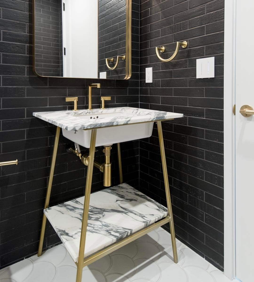 Custom designed powder bath vanity in our Seaholm build.    Designed by @slicdesign  Built by @foursquarebuilders  Photo by @redpantsstudio