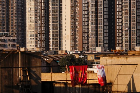 A view from my old apartment in Changsha displays new high rise buildings as a backdrop for older homes that are quickly being demolished.