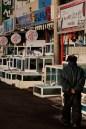 A man walks past restaurants in the port area of Jeju City.