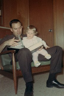 My dad and me looking through family photos.