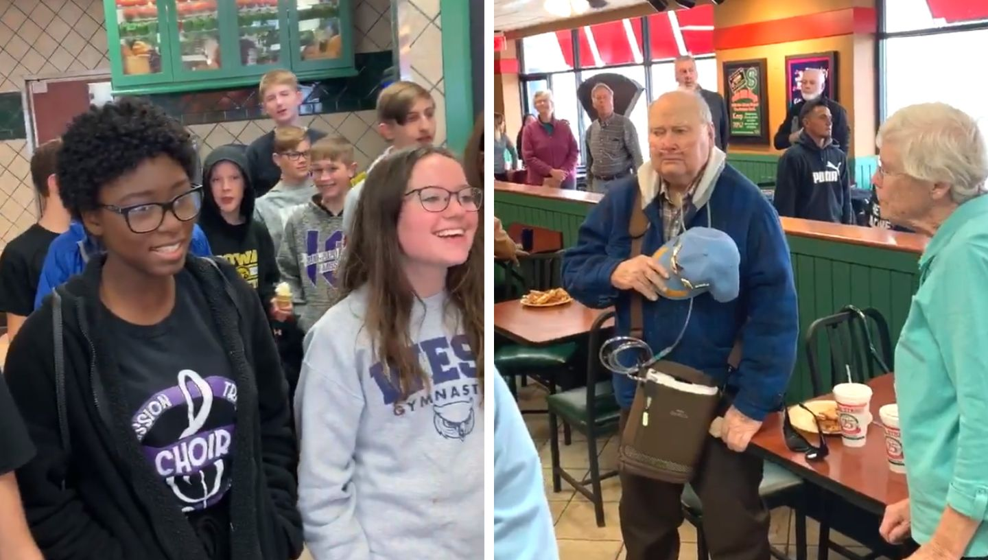 Picture of students singing to navy vet at Pizza Street