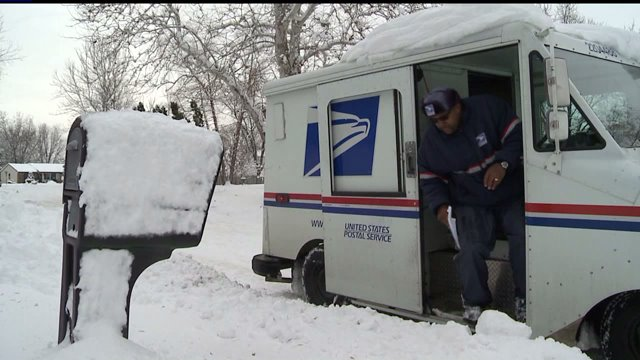 Postal workers braving the weather to deliver mail