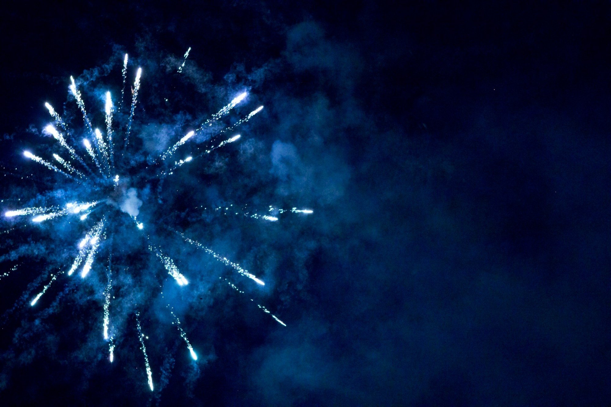 Blue fireworks with heavy smoke.