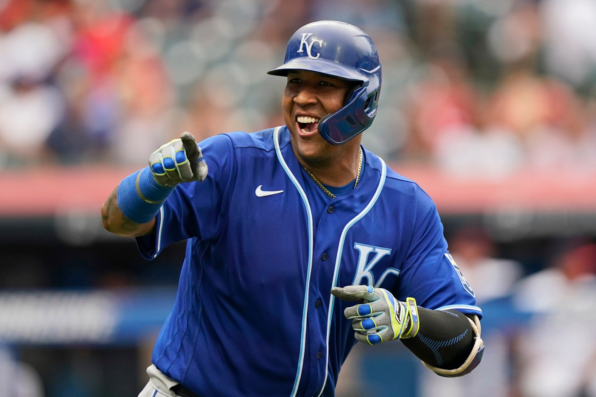 Kansas City Royals' Salvador Perez smiles and points to the dugout after hitting a two-run home run in the fifth inning in the first baseball game of a doubleheader against the Cleveland Indians, Monday, Sept. 20, 2021, in Cleveland. The home run broke Johnny Bench's record for the most home runs in a season by a primary catcher. (AP Photo/Tony Dejak)