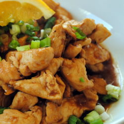 This award-winning Orange Ginger Chicken recipe is a healthier homemade alternative to takeout or Trader Joe's. The whole family will love this stir fried chicken breast glazed in orange ginger sauce. | foxeslovelemons.com
