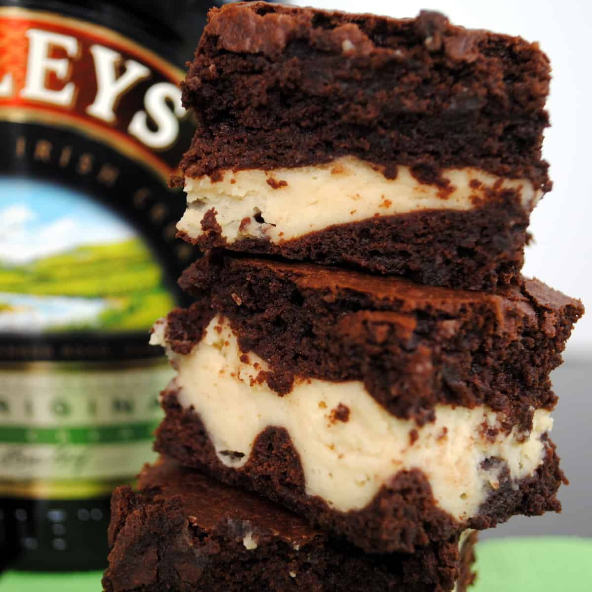 These Irish Cream Brownies are decadent chocolate brownies with a Baileys-spiked cheesecake center. Perfect for St. Patrick's Day . . . or any day! | foxeslovelemons.com