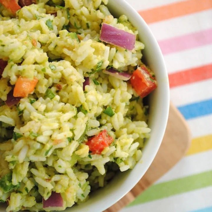 Guacamole Rice - all of the ingredients from guacamole, smashed into rice for a unique side dish! Serve warm or cold. | foxeslovelemons.com