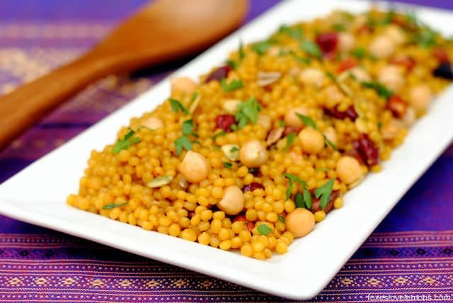 Curried Cranberry Couscous Pilaf – an easy yet elegant side dish of Israeli couscous tossed with chickpeas, dried fruit and nuts. | foxeslovelemons.com