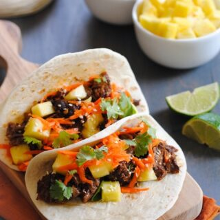 Asian Short Rib Tacos with Pineapple and Crunchy Slaw - a tasty meal where your slow cooker does all the work!   foxeslovelemons.com