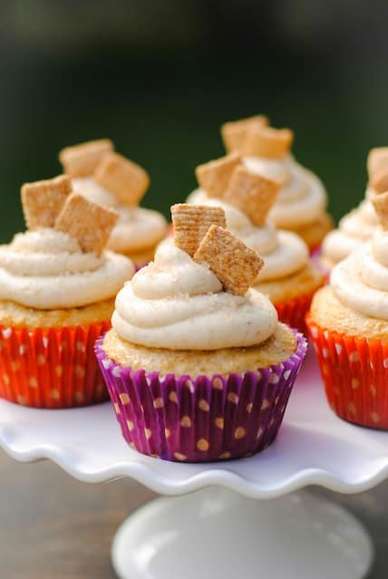 Cinnamon Toast Crunch Cupcakes - a festive cupcake that tastes just like the kid's cereal. Recipe originally published by Your Cup of Cake. | foxeslovelemons.com
