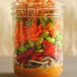 Pint sized mason jar filled with a layered Asian Noodle Salad.
