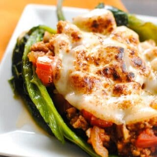 Picadillo Stuffed Chiles Rellenos - roasted poblano peppers stuffed with Cuban pork picadillo.   foxeslovelemons.com