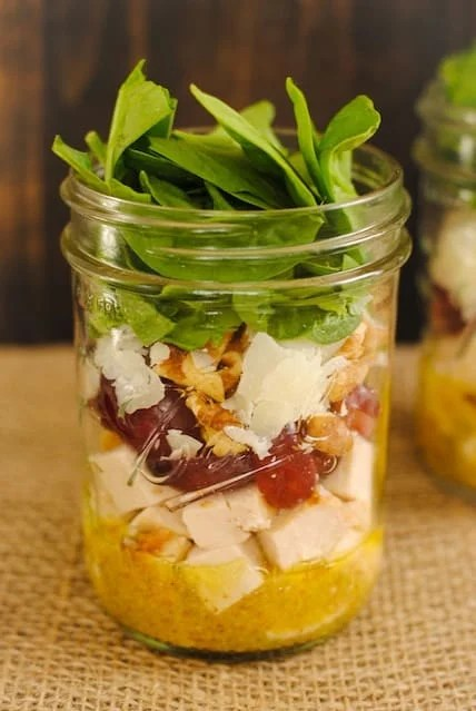 Chicken & Spinach Salad Jars - healthy and portable lunches for the work week! Lean chicken, sweet grapes, Asiago cheese, crunchy walnuts and spinach, dressed with Mustard-Thyme Vinaigrette. | foxeslovelemons.com