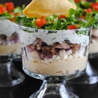 Chicken Shawarma Seven Layer Dip - A crowd-pleasing Middle Eastern-inspired layered dip!   foxeslovelemons.com