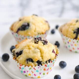 Best-Ever Blueberry Muffins - Moist, flavor-packed blueberry muffins flecked with lemon zest and finished with crunchy sugar for a coffee shop-style muffin.   foxeslovelemons.com