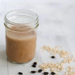 Mocha-Banana Breakfast Smoothie - A fruity smoothie and a cup of coffee...all in one! Get the energy to power through your day with this recipe! | foxeslovelemons.com