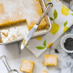 Meyer Lemon Bars with Poppyseed Crust - A flaky poppyseed crust topped with tart and sweet Meyer lemon filling. | foxeslovelemons.com