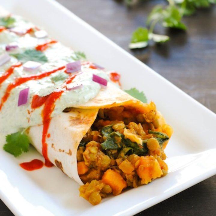 Vegetarian burrito on white rectangle plate.