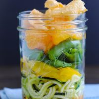 Asian Zoodle Salad Jars - Spiralized zucchini noodles, yellow bell pepper, sugar snap peas, mandarin oranges, crunchy wonton strips and sesame-ginger dressing. A portable and healthful make-ahead lunch!   foxeslovelemons.com