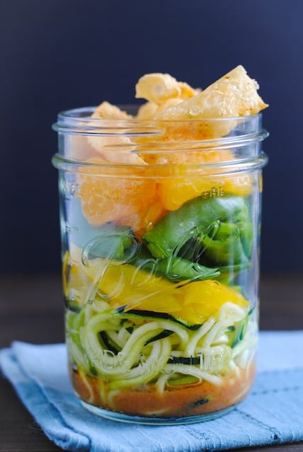 Asian Zoodle Salad Jars - Spiralized zucchini noodles, yellow bell pepper, sugar snap peas, mandarin oranges, crunchy wonton strips and sesame-ginger dressing. A portable and healthful make-ahead lunch! | foxeslovelemons.com