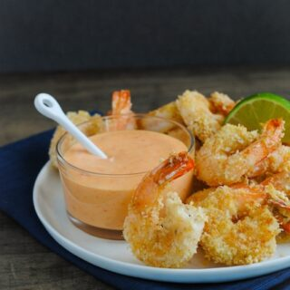 Baked Coconut Shrimp with Creamy Sweet Chili Sauce - A light and delicious restaurant-quality meal or appetizer that comes together in just minutes!   foxeslovelemons.com