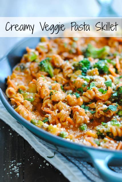Creamy Veggie Pasta Skillet - A hearty vegetarian meal that comes together in one skillet. Creamy pasta loaded with carrots, broccoli and peas. | foxeslovelemons.com