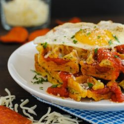 Pizza for Breakfast! Waffles - Savory waffles studded with pepperoni, topped with pizza sauce, mozzarella cheese and a sunny side up egg! | foxeslovelemons.com