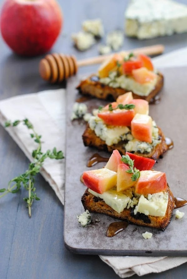 Raisin Crostini with Blue Cheese & Apples - Sweet, savory and cheesy. A pretty party bite that is a cinch to pull together! | foxeslovelemons.com